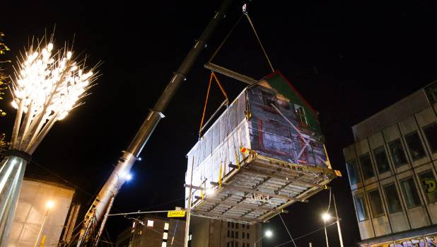A 200-tonne crane lifted Shand's three storeys into the air, to clear tram wires.