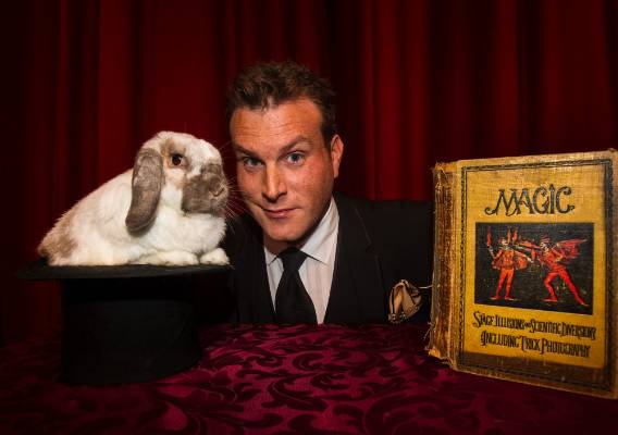 Magician Mick Peck and rabbit at the Rose Theatre In Belmont Auckland.