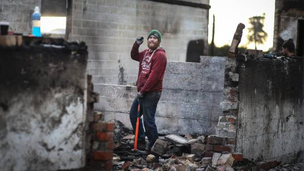 Jos Reekers lends a helping hand to clean up after the Vilagrad fire. As a youngster he worked at the winery.