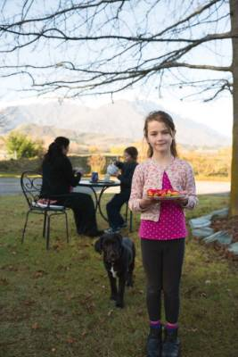 Sam has tea in the garden with her daughters Gwynie and seven-year-old Alie (front).