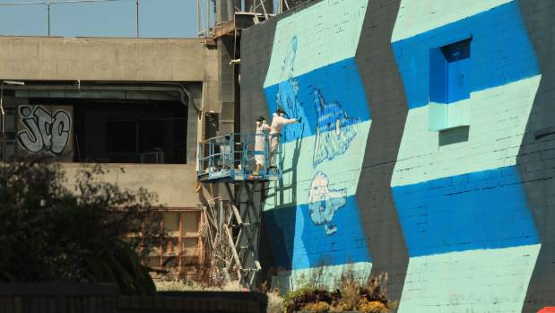 Wellington street artists BMD create a large blueprint-inspired piece of street art in Cashel St.