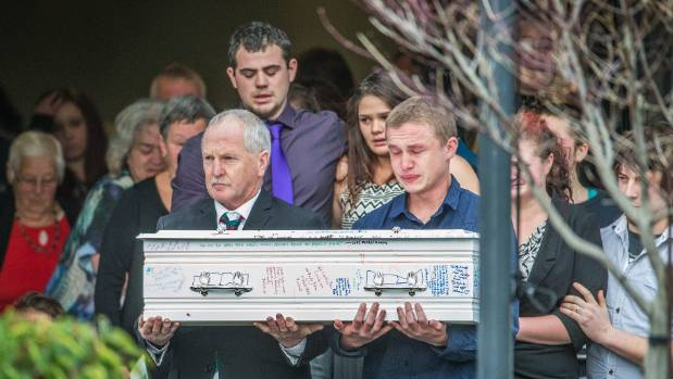 Troy Taylor (rear, purple tie) alongside Mikala Stokes at Ihaka's funeral. Grandfather Paul Stokes carries the coffin ...