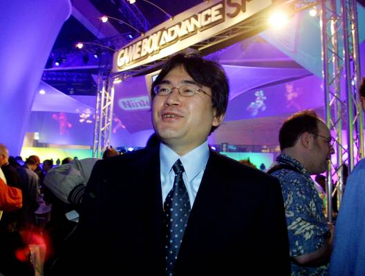 Nintendo CEO Satoru Iwata on the floor of the Nintendo exhibit at the Electronics Entertainment Expo in Los Angeles, May ...