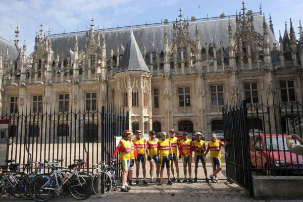 A cycle group pose in front of the palace of justice in Rouen.