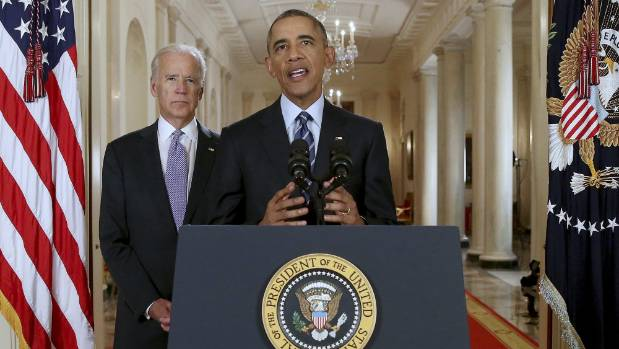 US President Barack Obama, flanked by vice president Joe Biden, delivers a statement after the nuclear deal was reached ...