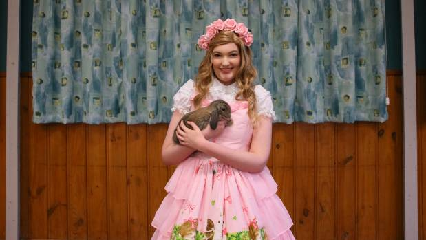 Hamilton woman Geralyn Herd, holding Angel, turned heads at the Waikato Rabbit Club show with her colourful costume.