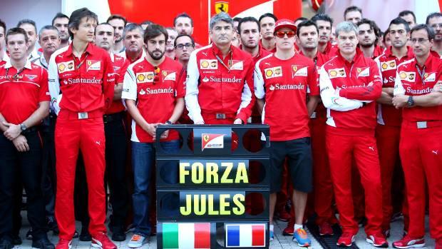 Members of the Ferrari and Marussia teams, including Fernando Alonso, Kimi Raikkonen and Ferrari Team Principal Marco ...