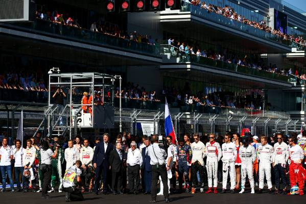 Drivers observe a short silence for Jules Bianchi before the Russian Formula One Grand Prix in 2014.