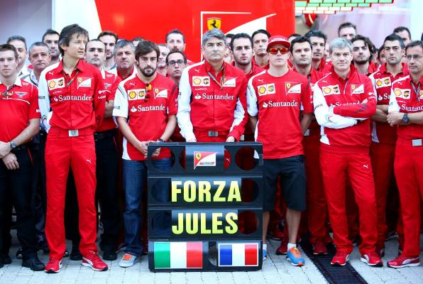 Members of the Ferrari and Marussia teams pay tribute to Jules Bianchi following his accident at Suzuka.