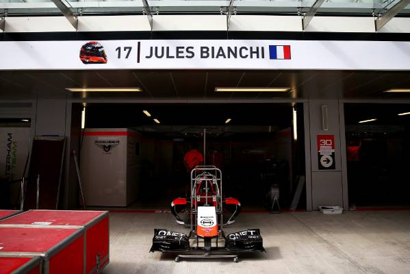 Jules Bianchi's name is displayed above his side of the team garage ahead of the 2014 Russian Grand Prix.