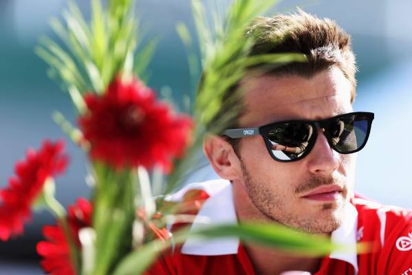 Jules Bianchi is interviewed in the paddock during previews to the Australian  Grand Prix in March, 2014.