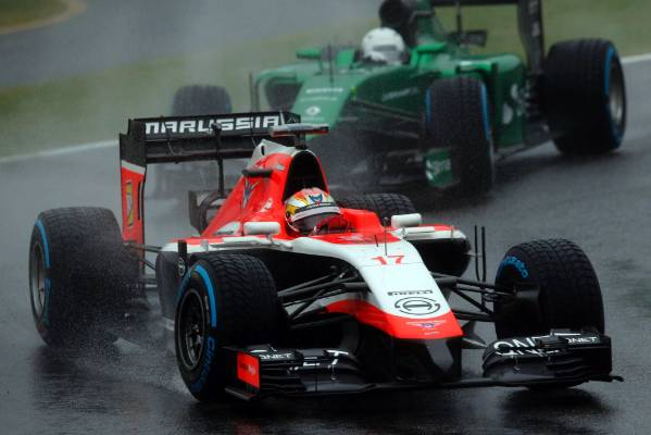 Jules Bianchi in action during the early stages of the 2014 Japanese Grand Prix at Suzuka.