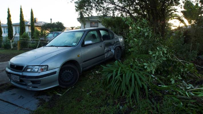 Car crashes through fence, into parked car in West Auckland | Stuff
