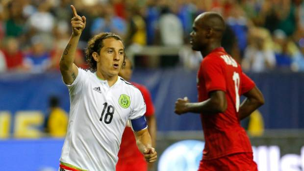 Mexico's Andres Guardado reacts after scoring his second penalty kick in extra time in El Tri's 2-1 victory over Panama ...