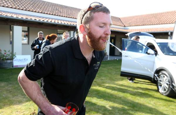 Anthony Walsh spits into a bucket in the Horty Sport challenge, as part of the Young Viticulturist of the Year ...