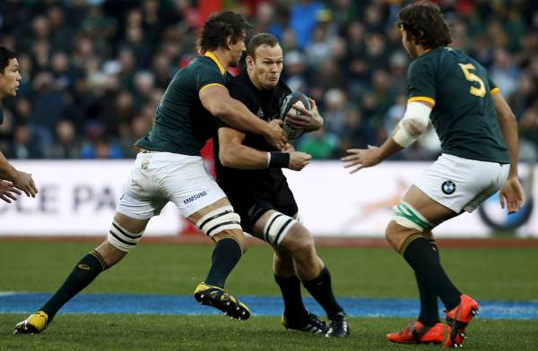 All Blacks debutant James Broadhurst is tackled by South Africa's Eben Etzebeth.