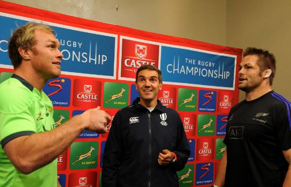 Springboks captain Schalk Burger flips the coin for his All Blacks counterpart Richie McCaw to make the call at the toss ...