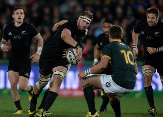 All Blacks No 8 Kieran Read shows the ball in an offload against the Springboks.