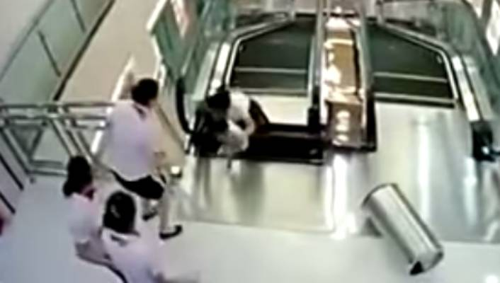 Mum saves child before being dragged to death in escalator