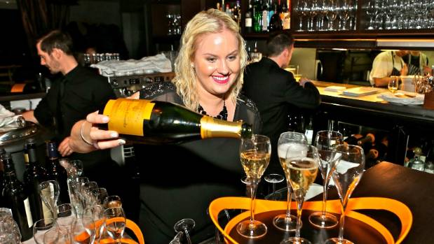 Veuve Clicquot New Zealand senior brand manager Rai Banbury pours one of tens of thousands of glasses of champagne for ...