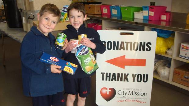 Samuel Frew, left, and Elliott O'Brien, both aged 6, donated items to the City Mission's foodbank after they asked for ...