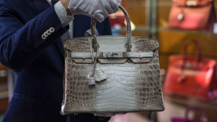 992af3542746 An employee holds an Hermes diamond and Himalayan Nilo Crocodile Birkin  handbag at Heritage Auctions offices