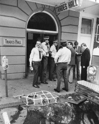 Police gather at the bombed Trades Hall on Vivian St on March 28, 1984.