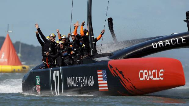 The Oracle crew celebrate after clinching victory in the winner takes all final race.