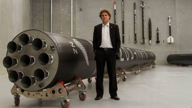 Rocket Lab founder and chief executive Peter Beck with the Electron rocket propulsion system.