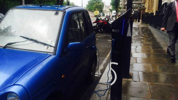 Old hat? An electric car is recharged on London's Embankment