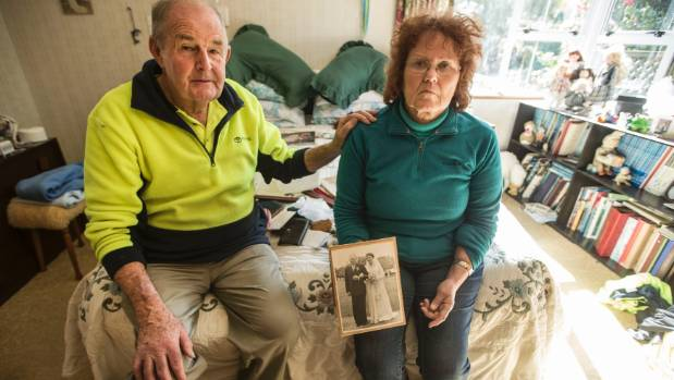 Carol and Alan in their Thames home with a photo of family who handed down heirlooms.