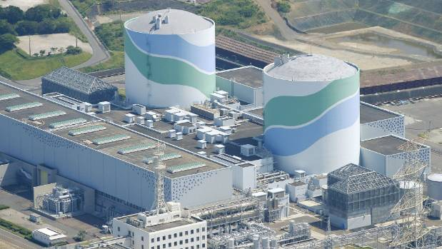 The No.1, left, and No.2 reactor buildings at Kyushu Electric Power's Sendai nuclear power station in Satsumasendai, ...