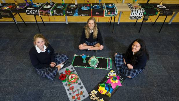 Nelson College for Girls students Georgia Bailey, 14, Emma Pegg, 15, and Kaylani Boyd, 14, with their art work ...