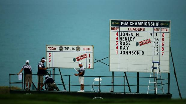 Bad weather forces play to be suspended for the day at PGA
