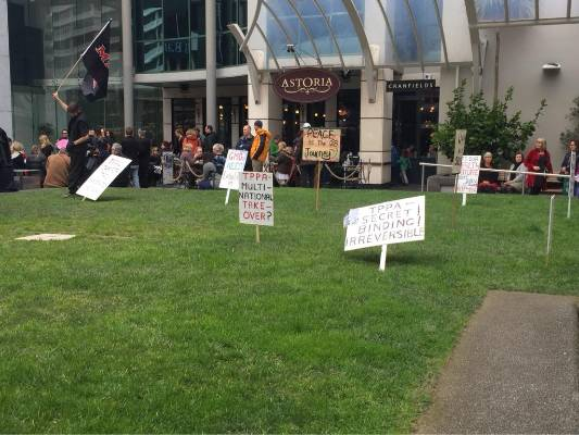 Just some of the signs people have prepared for a protest march in Wellington against the Trans-Pacific Partnership.
