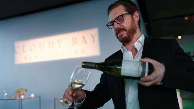 Cloudy Bay winemaker Tim Heath pours sauvignon blanc into a glass during an event to launch a vintage in New York.