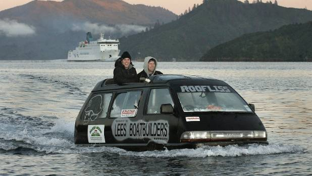 Dan Melling and Adam Turnbull on board amphibious van Roofliss during their voyage across Cook Strait.