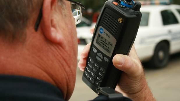A Tait Communications digital radio is used by a policeman in the United States.