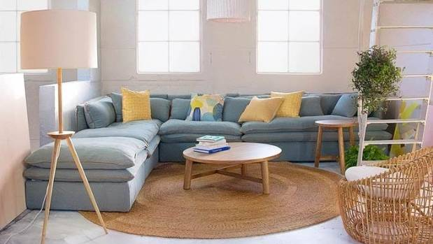 A round rug can pull a room together when you can't afford a larger, rectangular option.