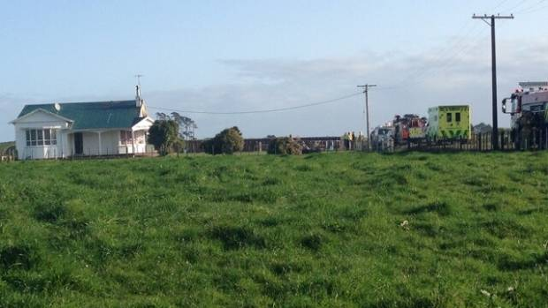 Firefighters and ambulance staff are at the scene of a house fire in Coastal Taranaki.