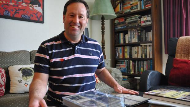 Wellington man Glenn Reddiex with his postcard collection. He has released a book of postcards from World War I.