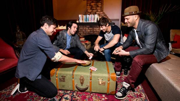 The Band of Magicians, made up of Adam Mada, left, Brett Loudermilk, Ben Hanlin and James Galea, are on stage in New ...