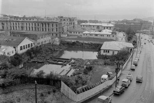 The future site of Broadcasting House on Bowen St in 1955, when it was a boggy water reservoir behind Parliament.