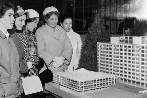 A group of women inspects an architectural model of Broadcasting House, left, and neighbouring Bowen House in July 1959.