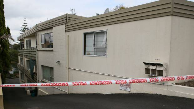 Police tape off an area of flats on Victoria St Hamilton after a stabbing on Saturday.