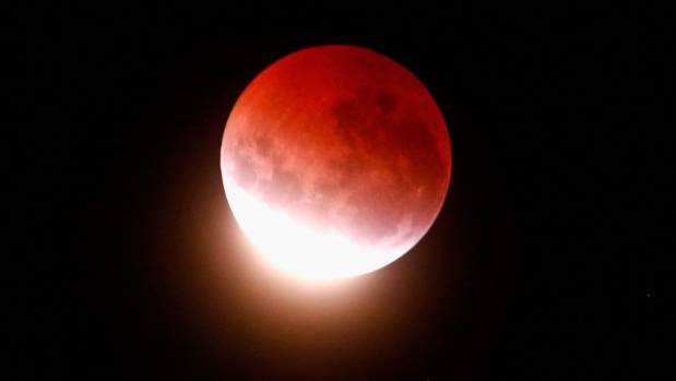A blood red moon lights up the sky during a total lunar eclipse on April 4, 2015 in Auckland.