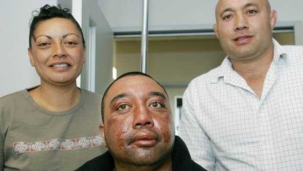 Rob Hewitt, centre, the day after his sea ordeal ended on February 8, 2006, pictured with fiancee Rangi Ngatai and ...
