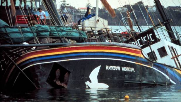 The Rainbow Warrior lies half-submerged in Auckland Harbour after a bombing by French secret service agents in this 1985 ...