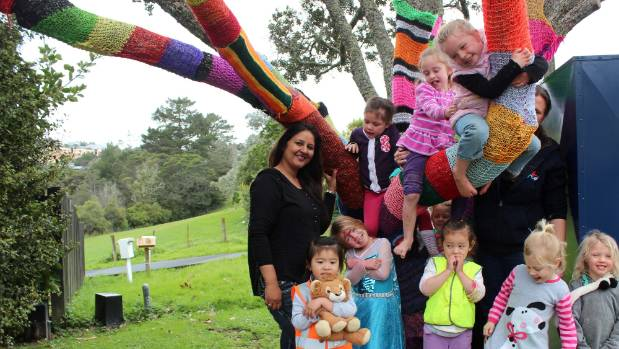 Parents and teachers of Kauri Park Kindergarten have been knitting scarves for its big tree.