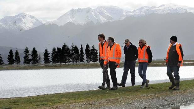 PDP environmental engineer Dan Garden, left, is led by Southland District Council Water and Waste services Manager Ian ...